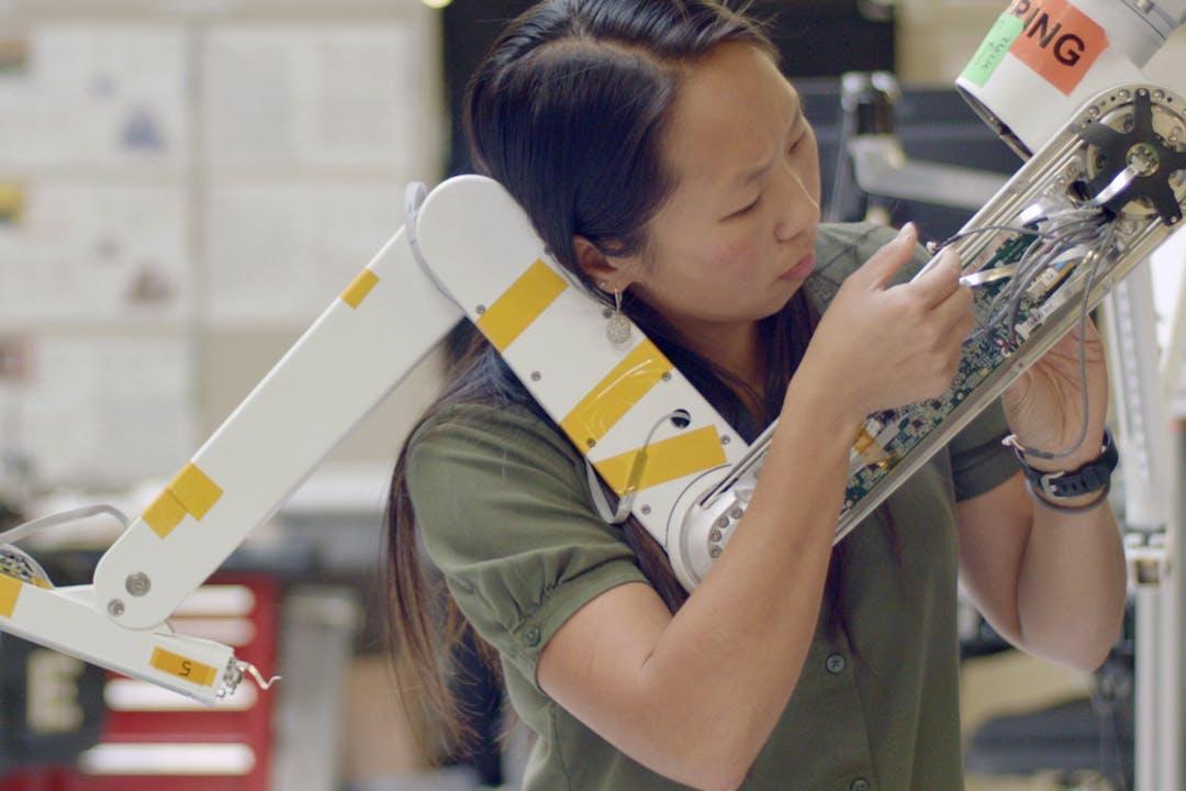 engineer working on robotic arm thumbnail 2