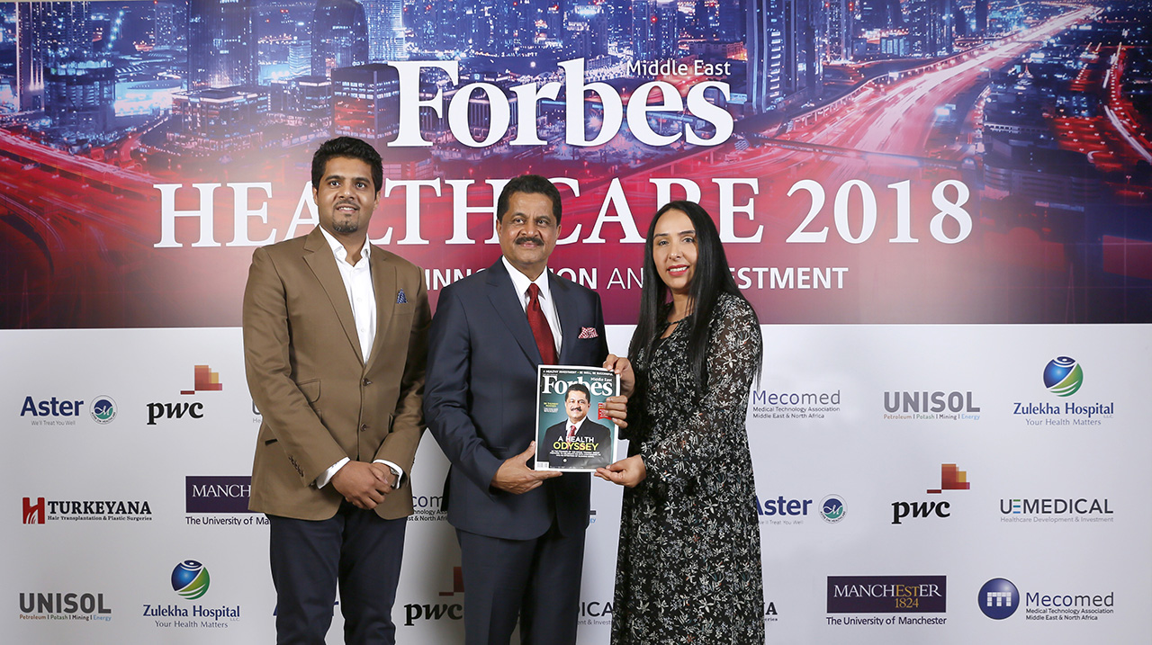 Forbes Middle East's Editor-in-Chief, Khuloud Al Omian, presents Thumbay Group founder, Dr Thumbay Moideen, with a copy of the healthcare special edition.
